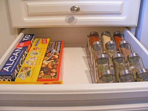 A Smaller Spice Rack Inside The Drawer With Other Storage Items.