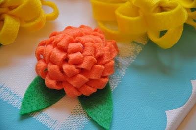orange felt flower