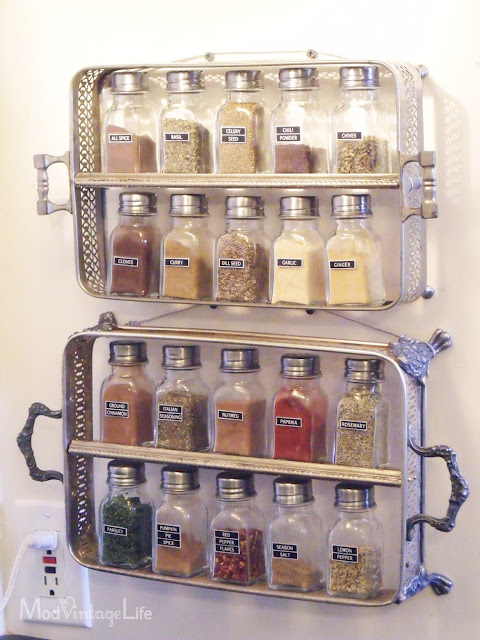 Beautiful A Stainless Steel Spice Rack On The Wall Near The Tap.